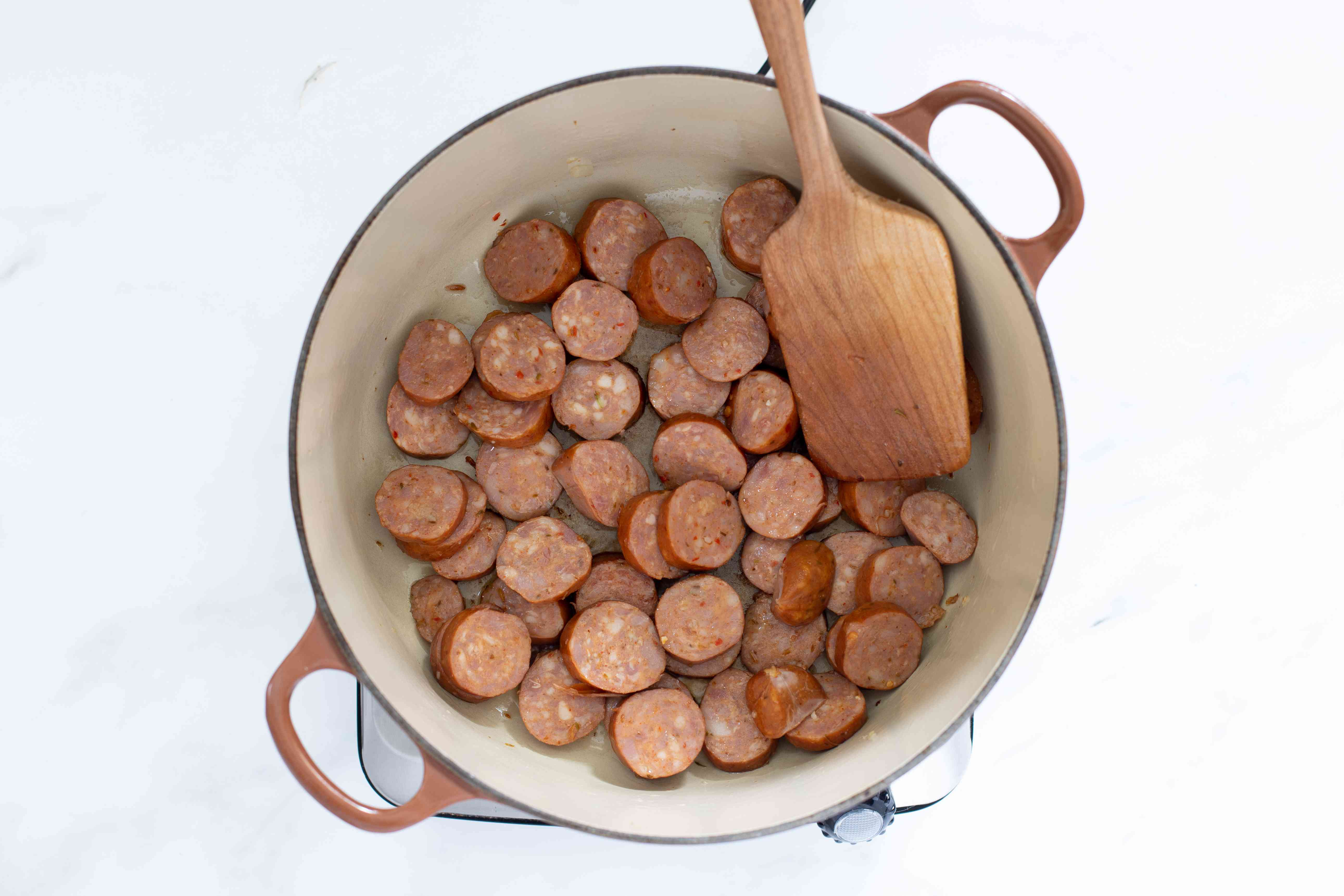 sausage is sauteed in a dutch oven