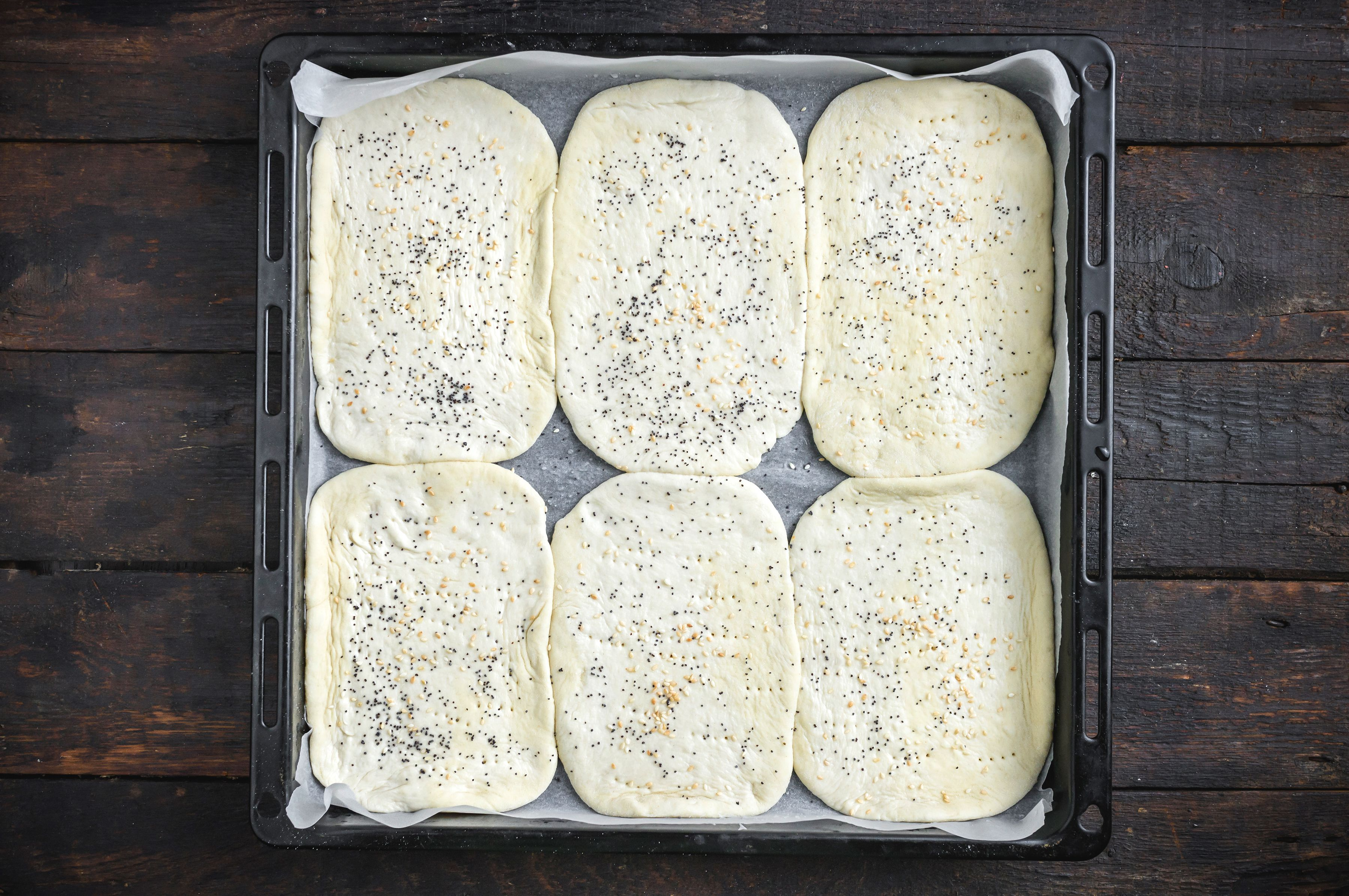 Brush dough with oil and sprinkle with poppy seeds and sesame seeds