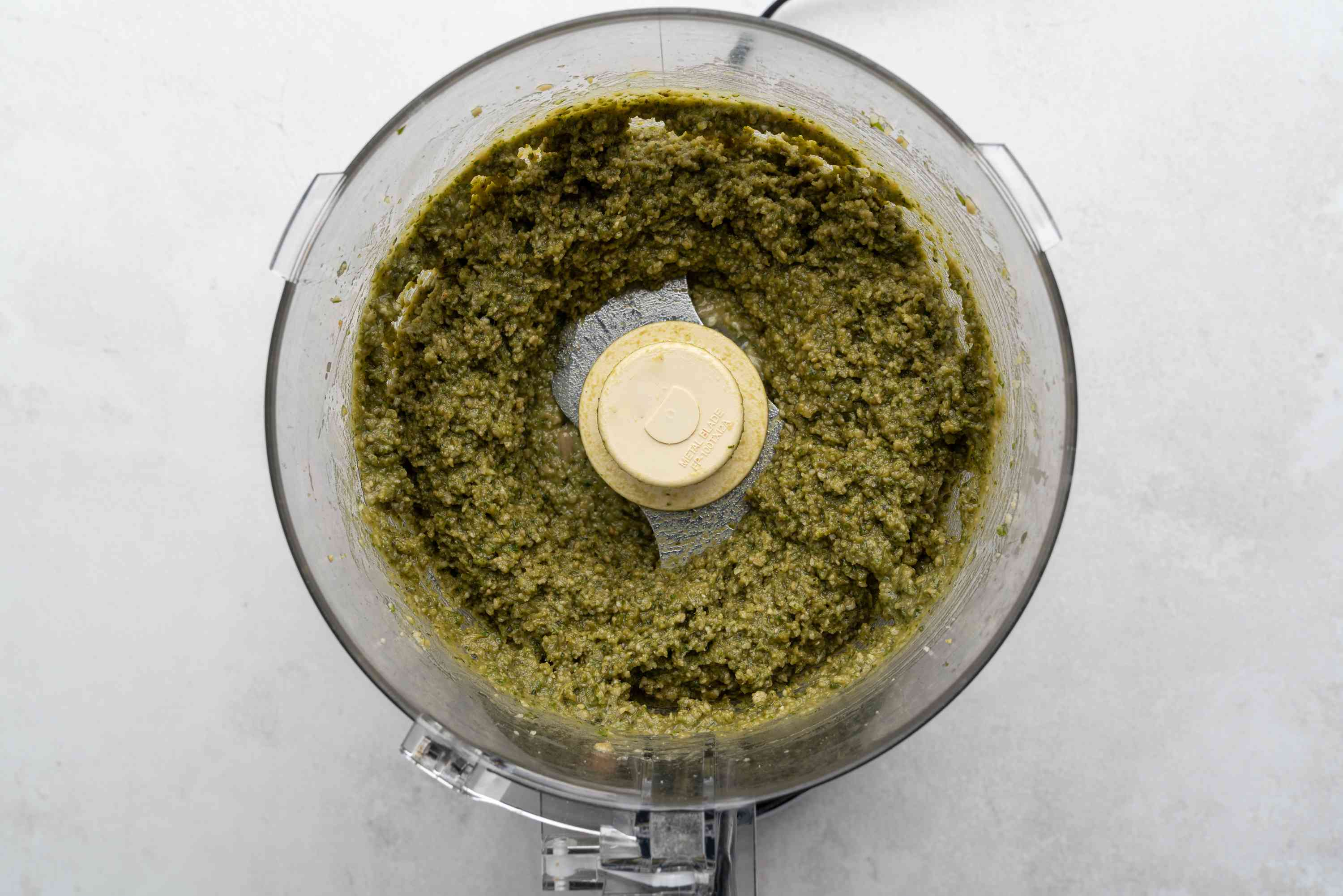 Place basil, sunflower seeds, olive oil, Parmesan, butter, and garlic in the bowl of a food processor