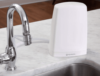 Water filter on countertop by sink