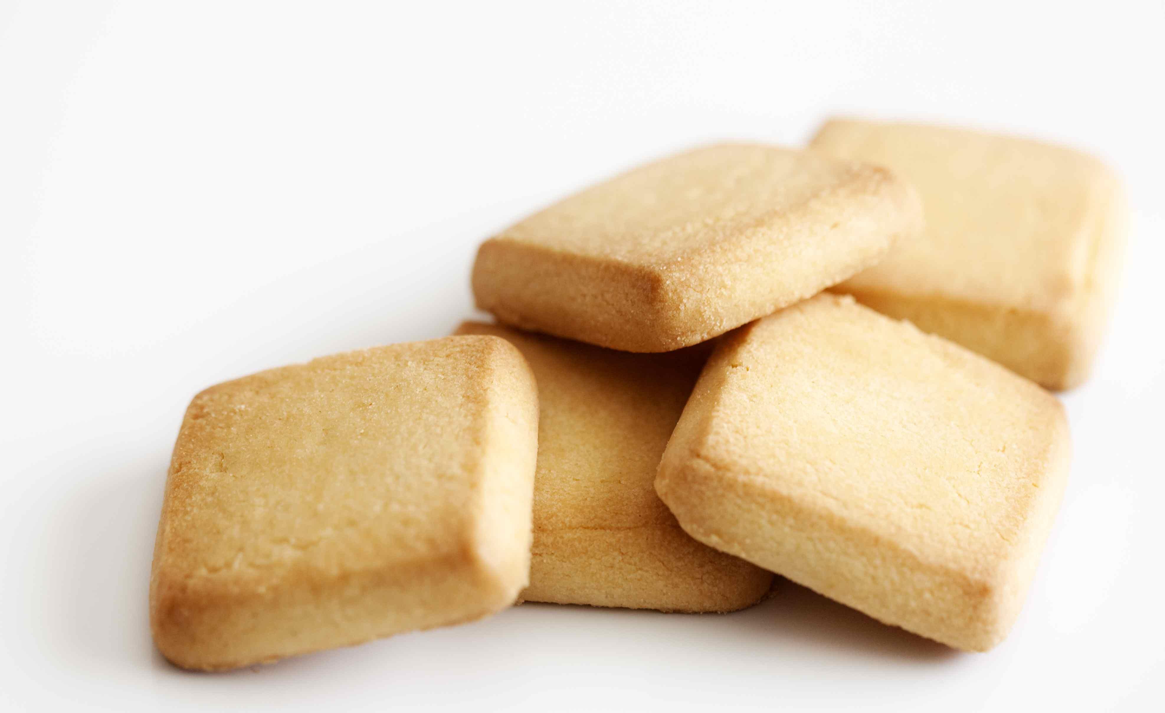 Five square-shaped gluten-free vanilla wafers