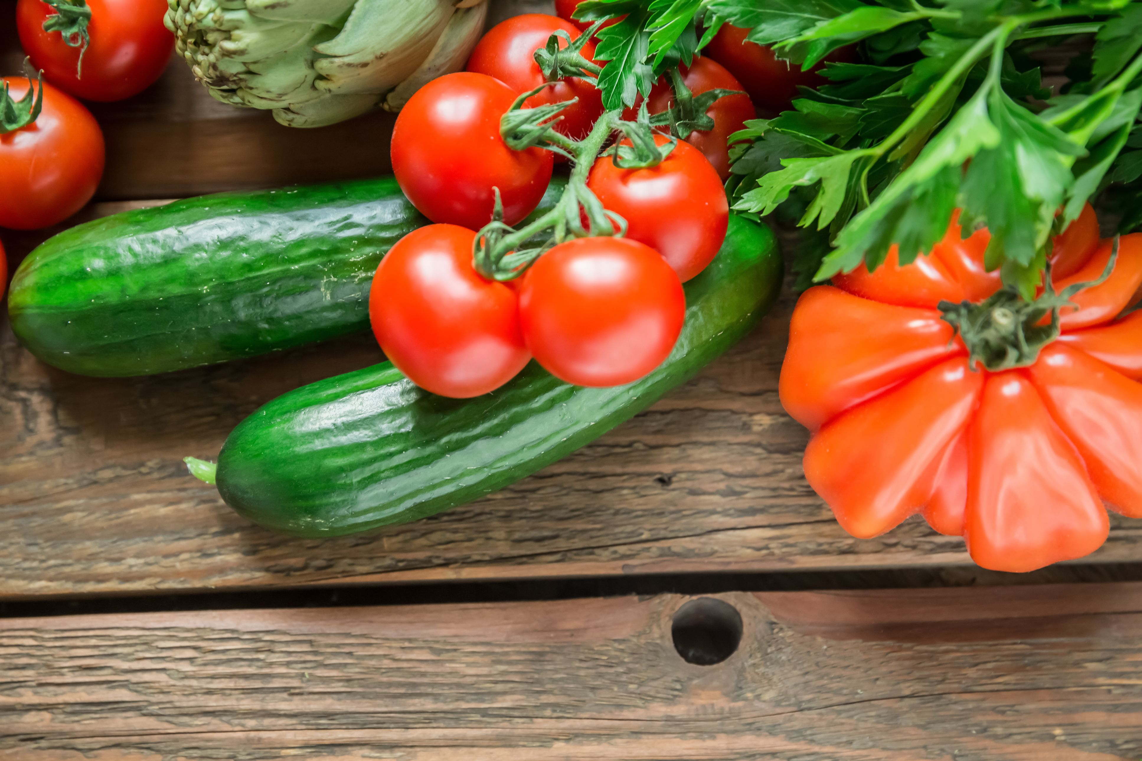 Cucumbers and Tomatoes on a wooden table