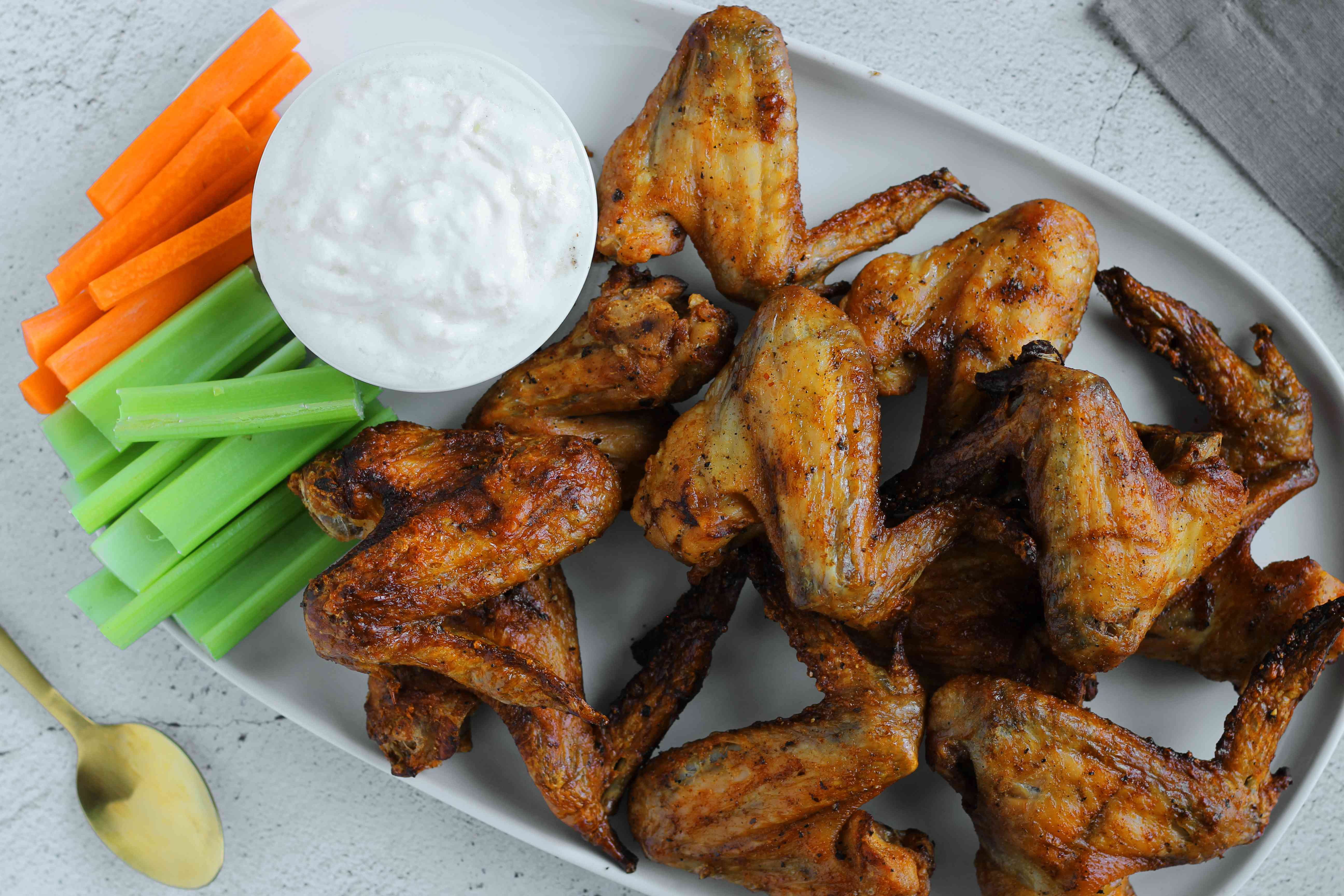 Salt and vinegar wings with dip, carrots and celery