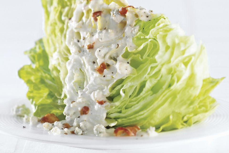 Iceberg lettuce with blue cheese dressing and bacon