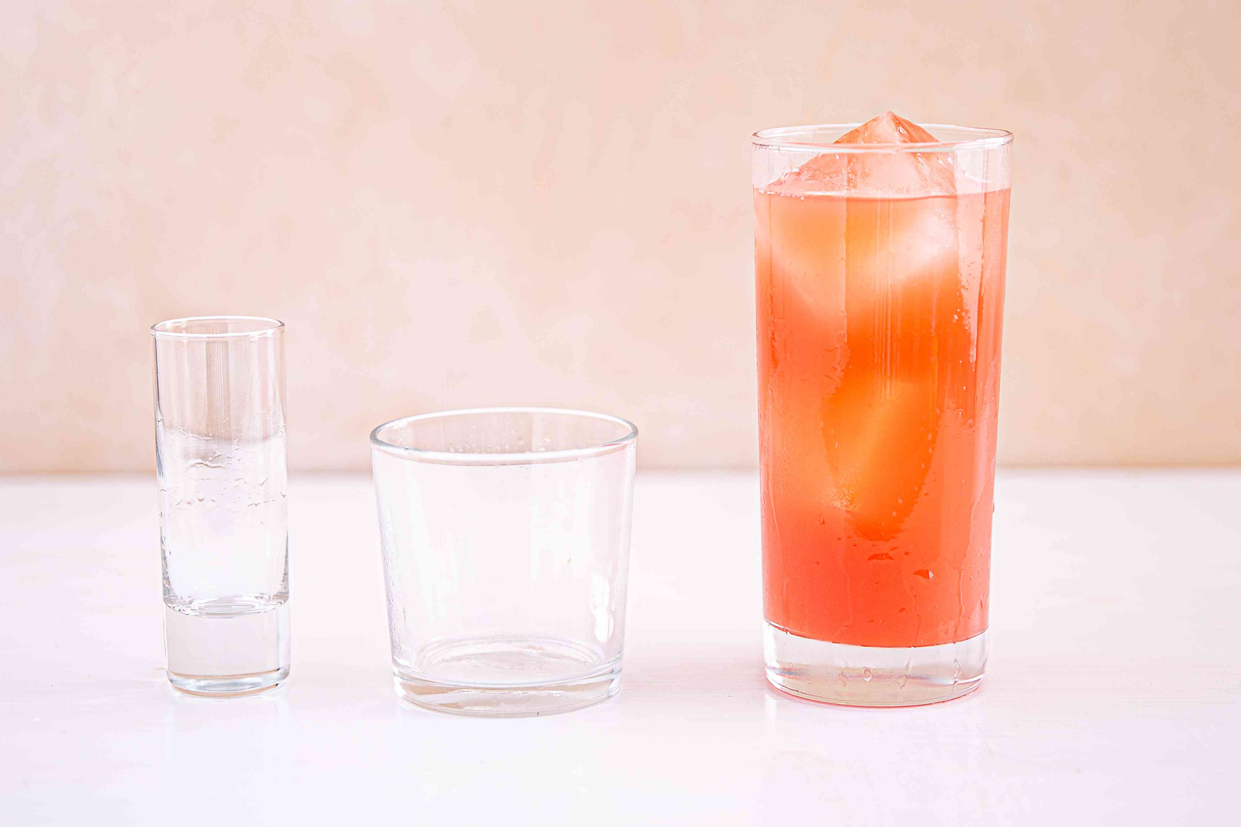 Grapefruit juice and vodka poured into a Collins glass