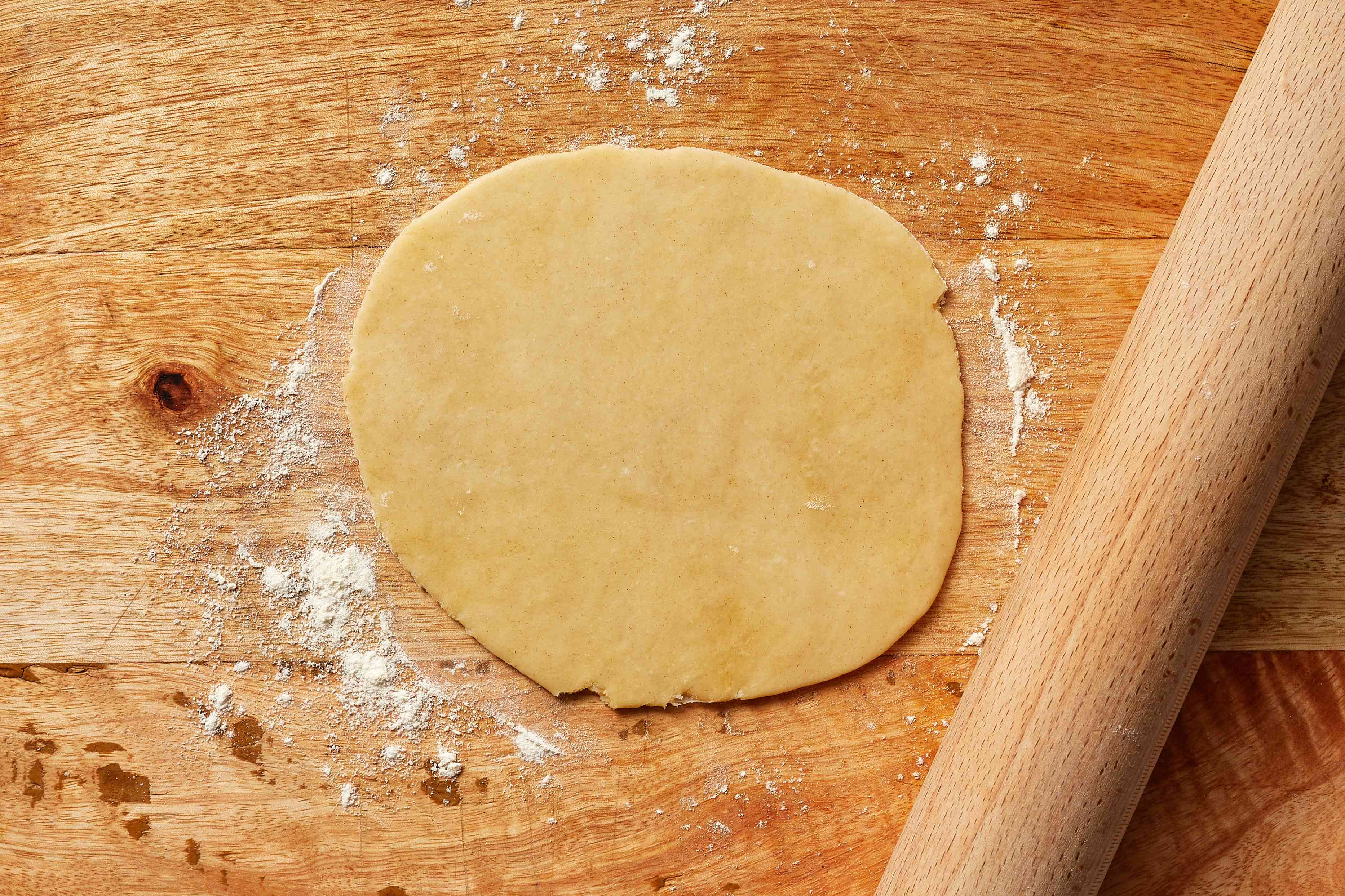 rolled out dough on a floured cutting board