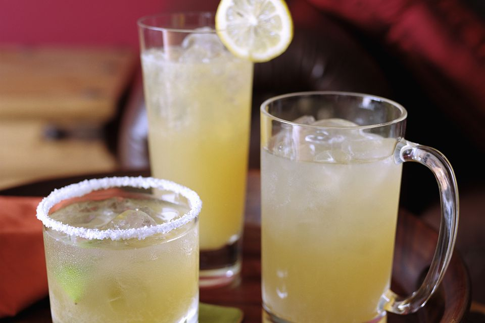 The classic and easy summer shandy recipe three ways: mixed with lemonade, served with a sugar rim, and topped withe a lemon wheel