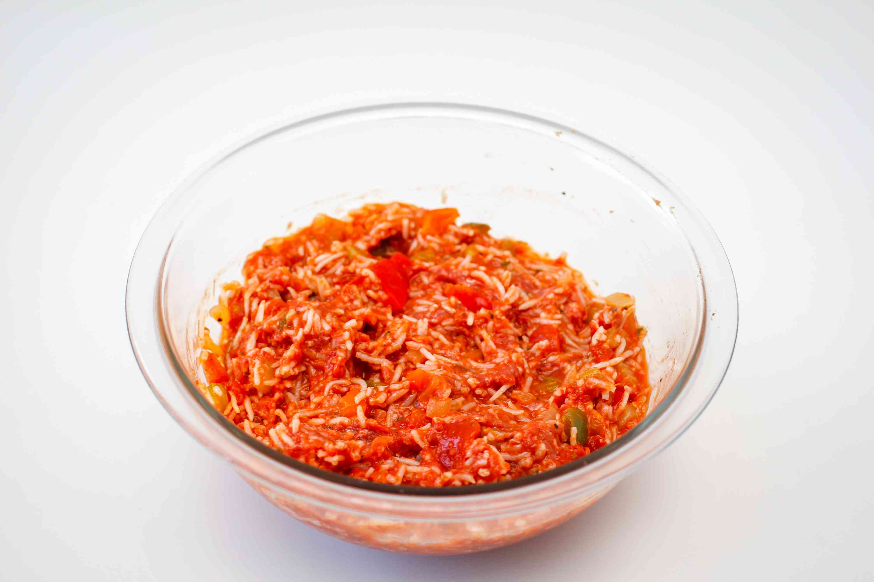 Ground beef mixed in a bowl with egg and tomato mixture