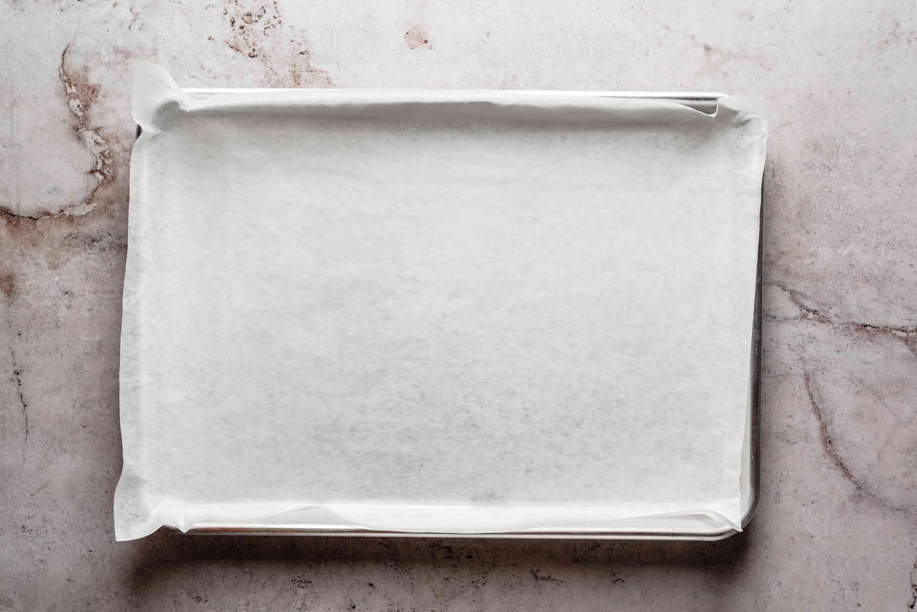 Prepare a baking sheet by lining it with parchment paper
