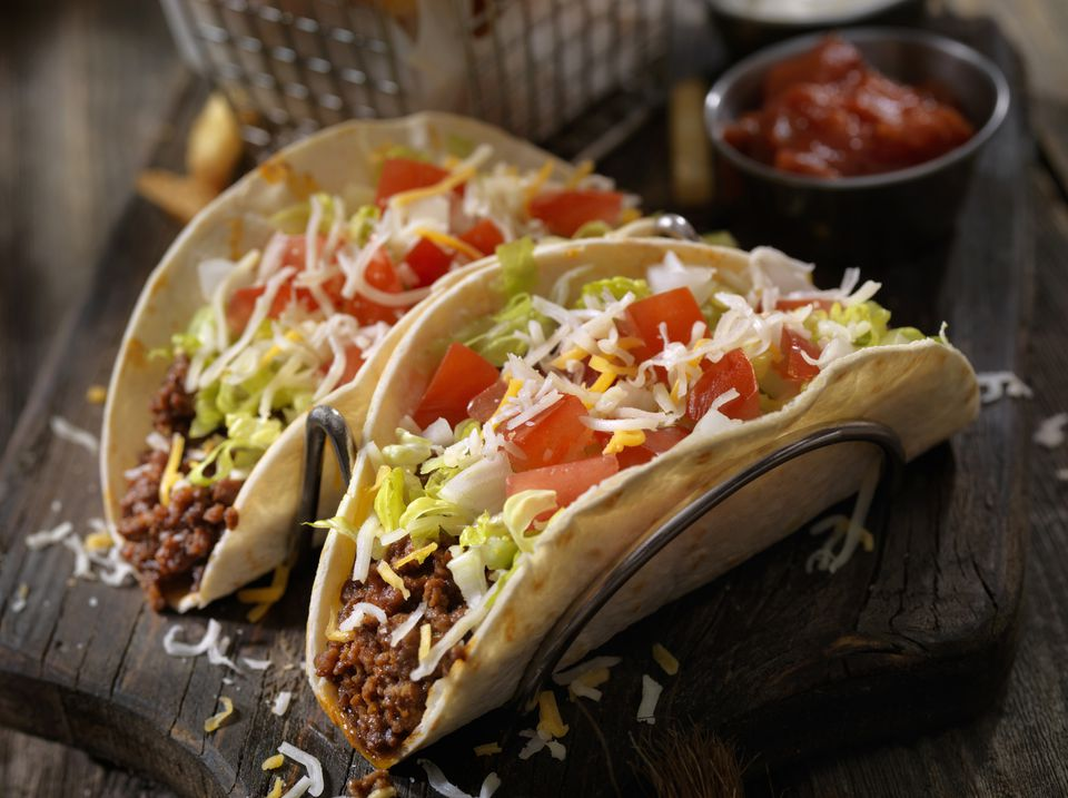 Soft beef tacos with lettuce, tomatoes and cheese