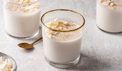 Cups of coconut pudding topped with toasted coconut