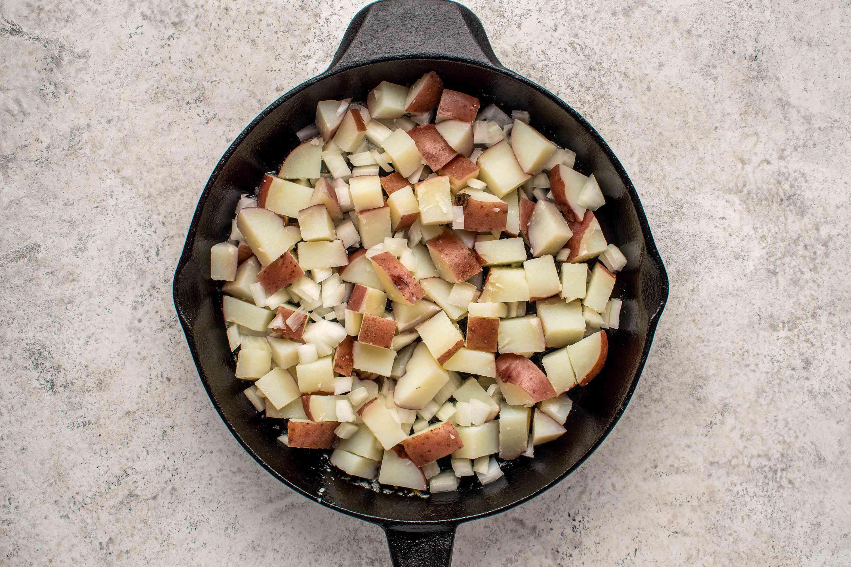 potato, onion mixture in a skillet
