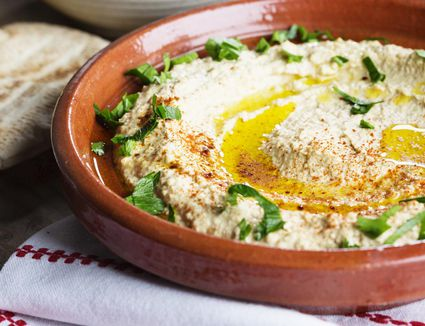 Hummus in a red bowl