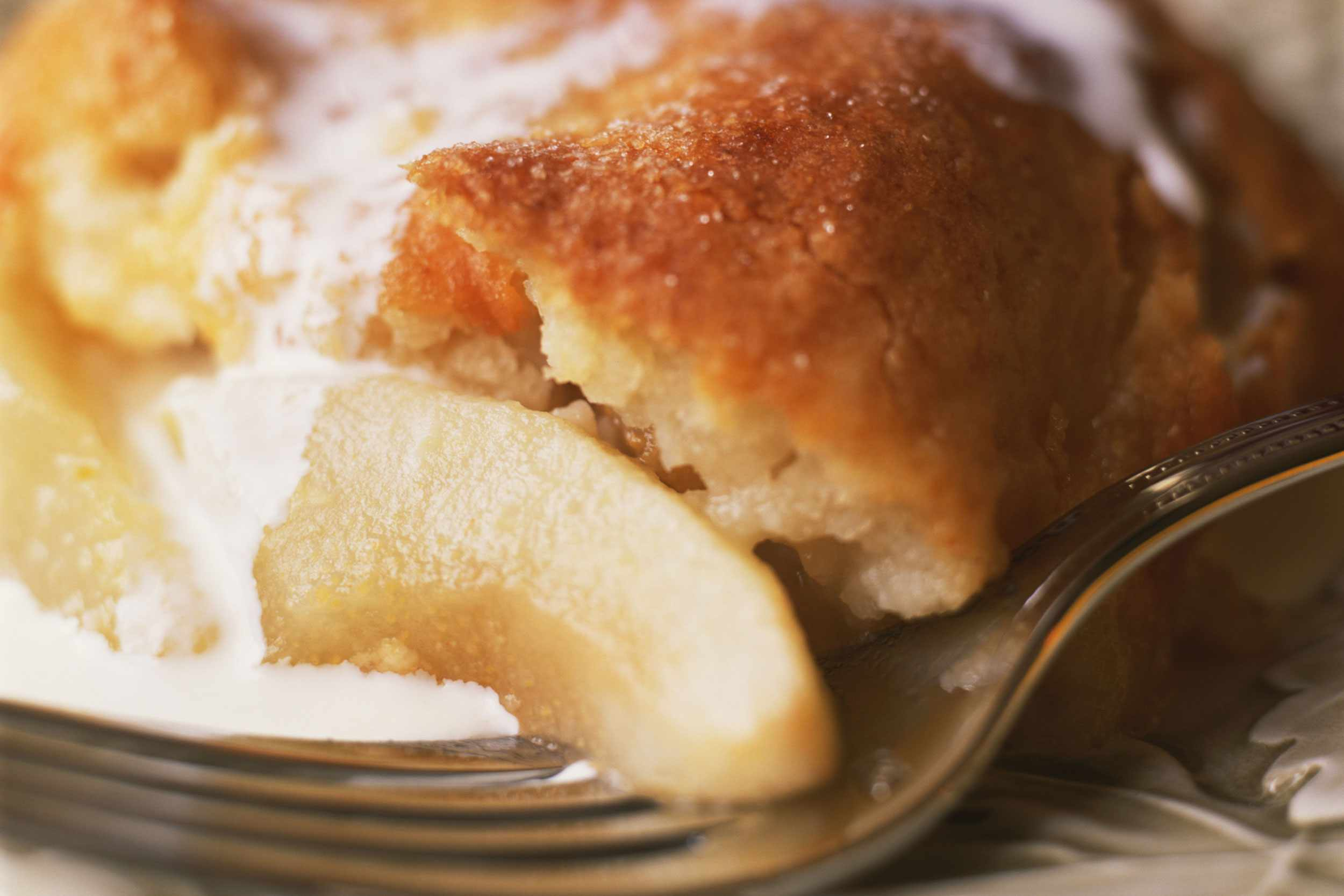 Close-up of easy pear cobbler with a fork