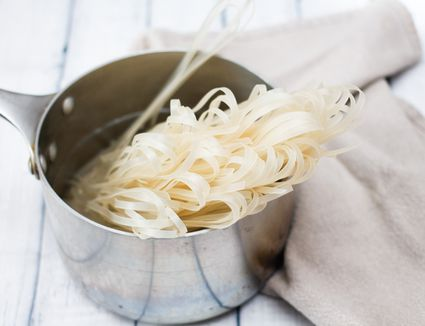 Rice noodles in a pot of water