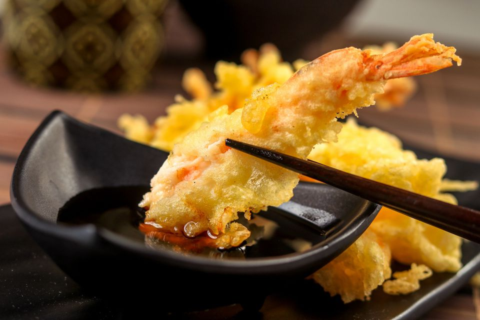 Shrimp tempura dipped in sauce