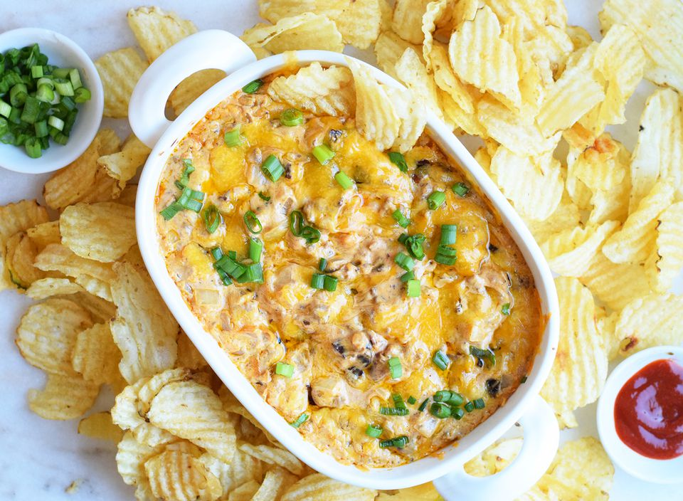 cheeseburger dip with potato chips on a platter