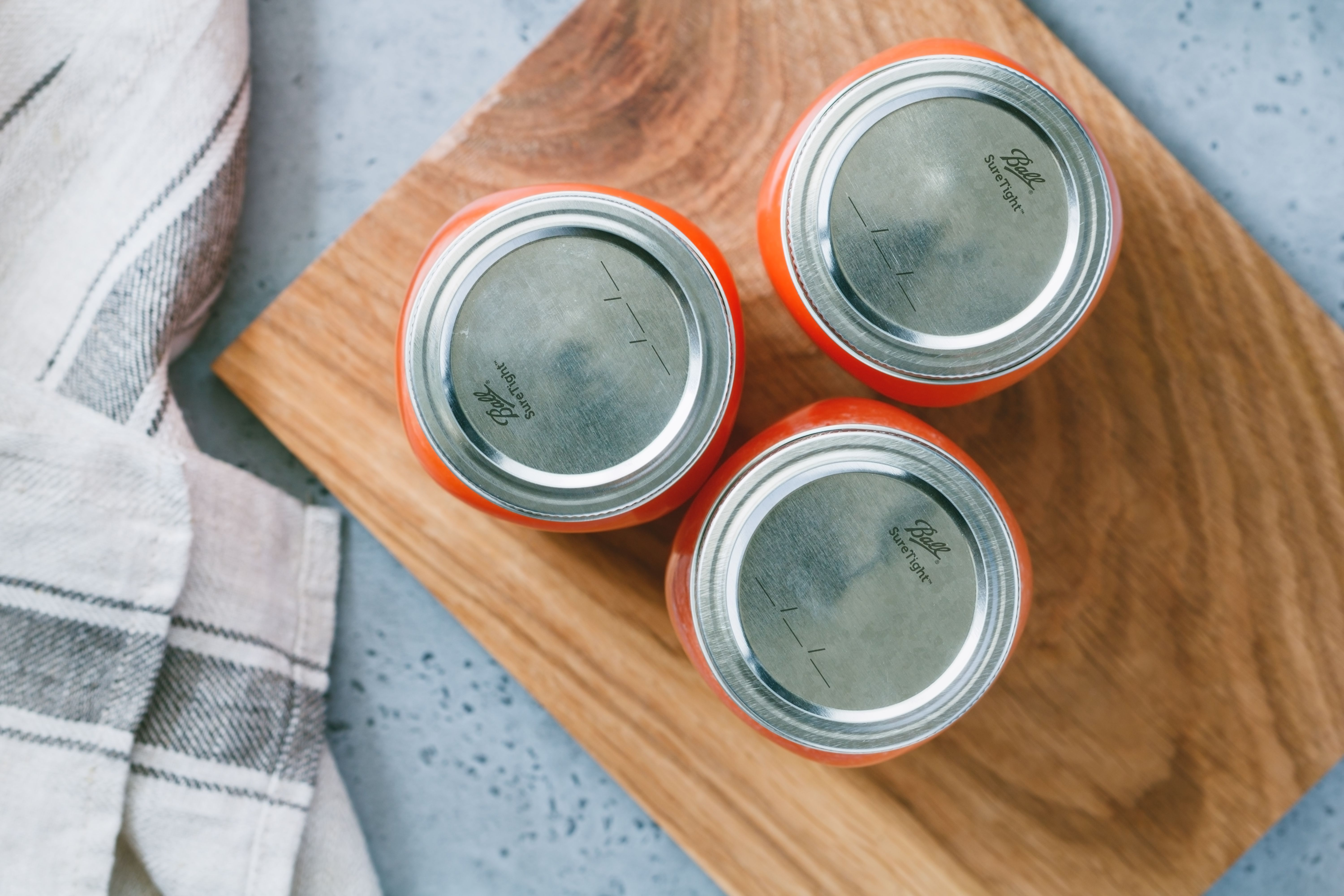 Tomato puree in jars topped with lids