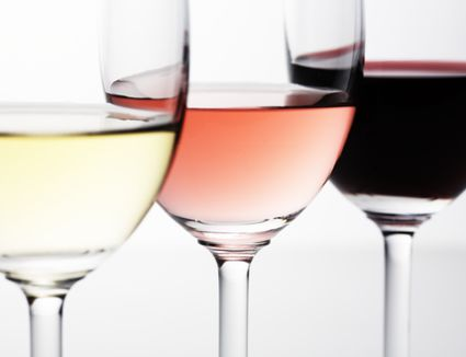 wine glasses with white wine, rose, and red wine