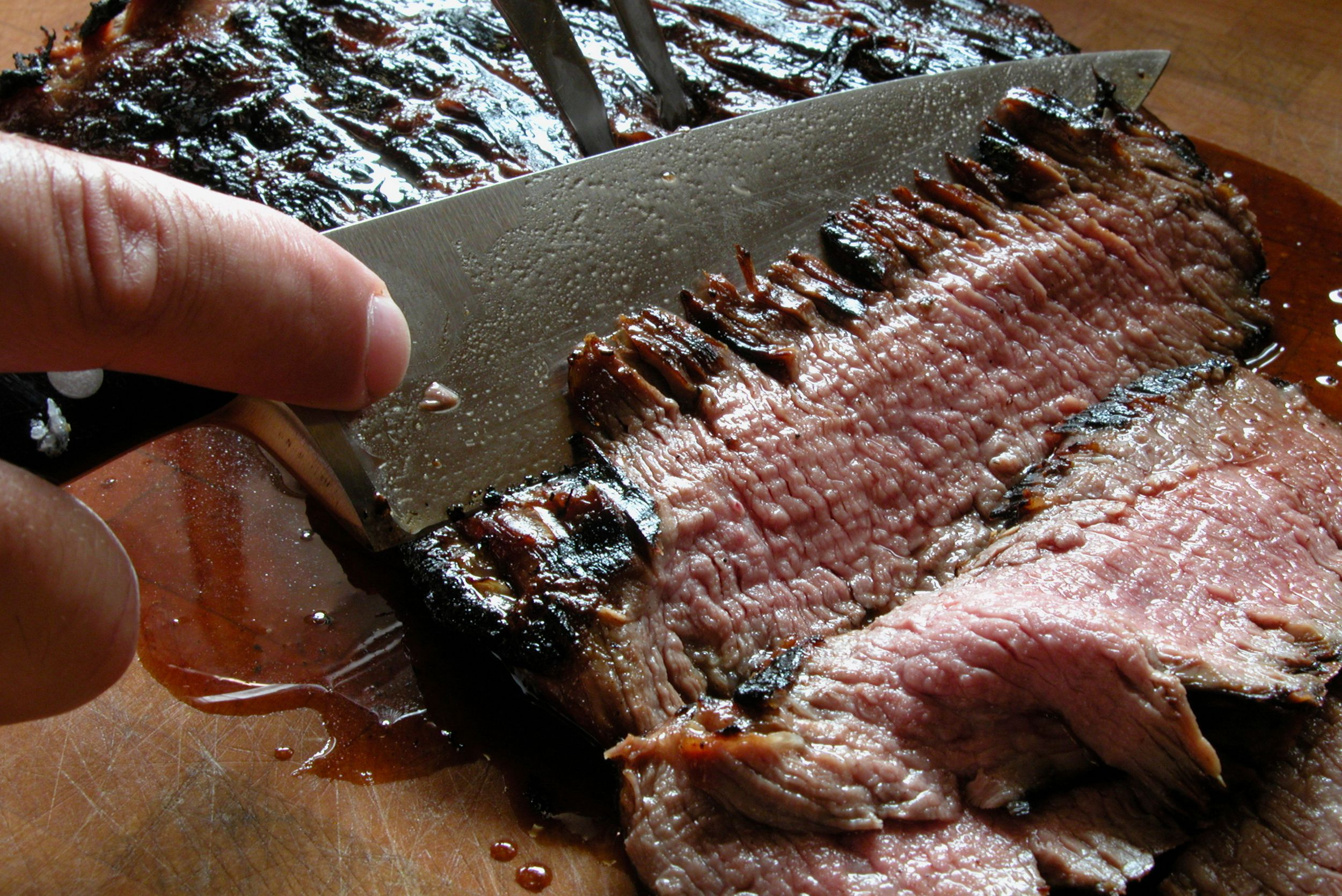 Slicing flank steak against the grain