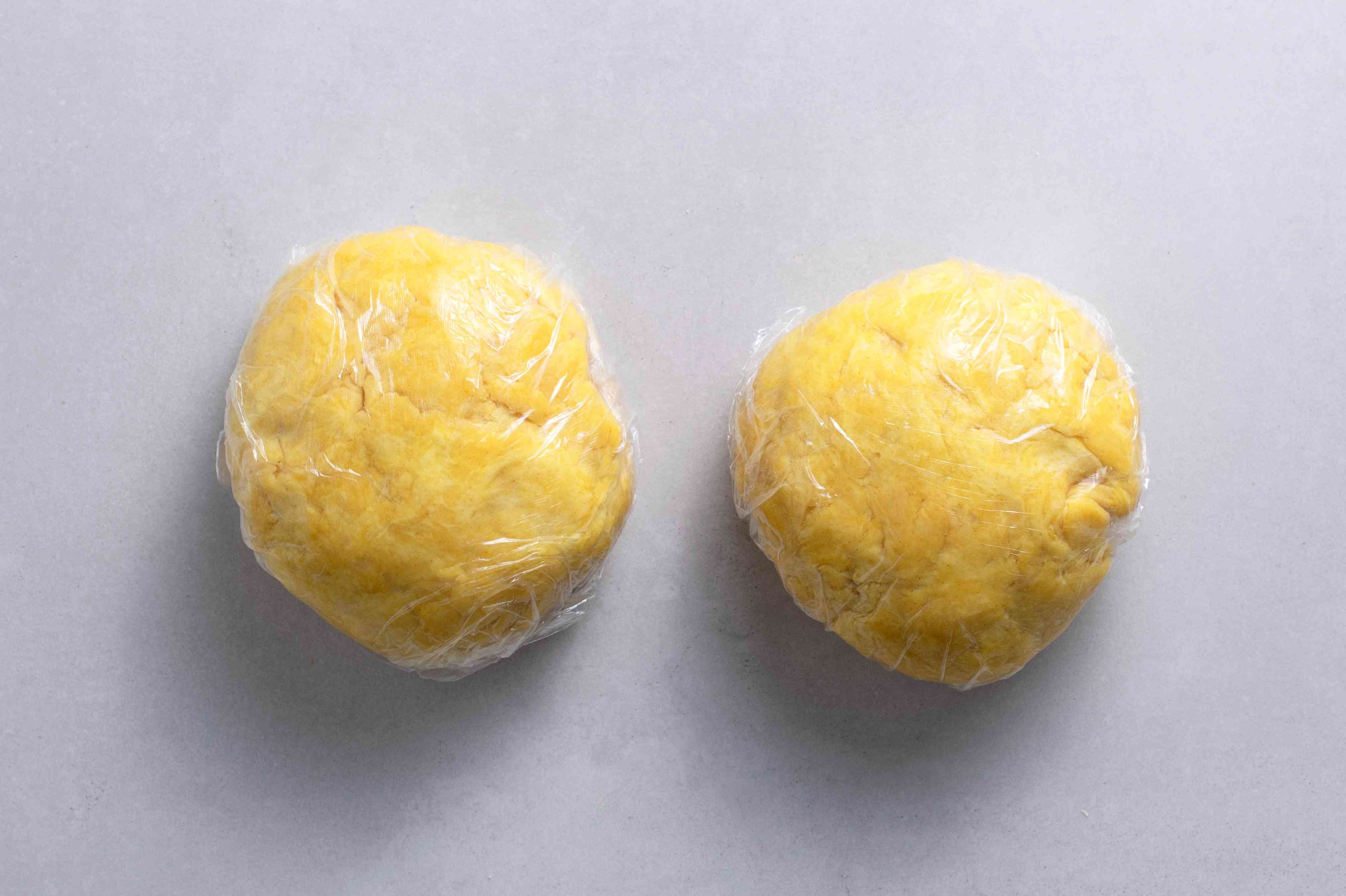 dough balls wrapped in plastic wrap
