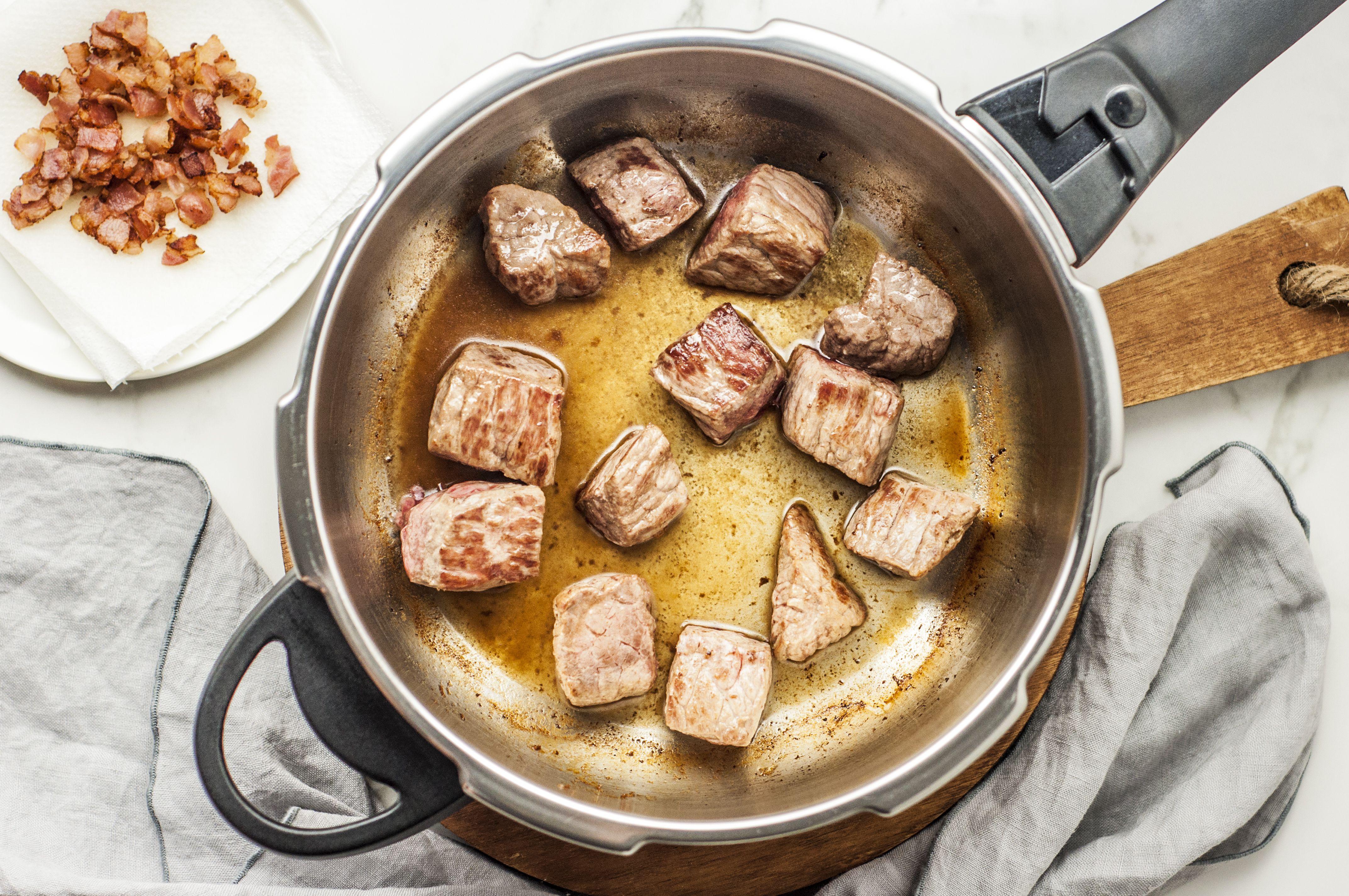 Cut the steak into cubes