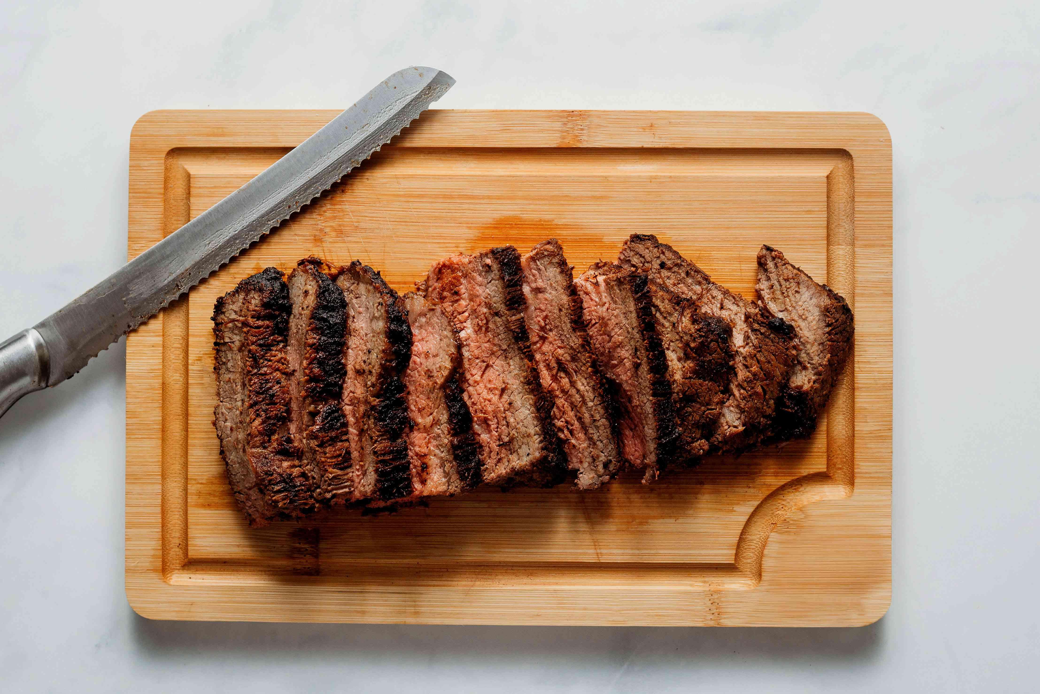 sliced steak on a cutting board