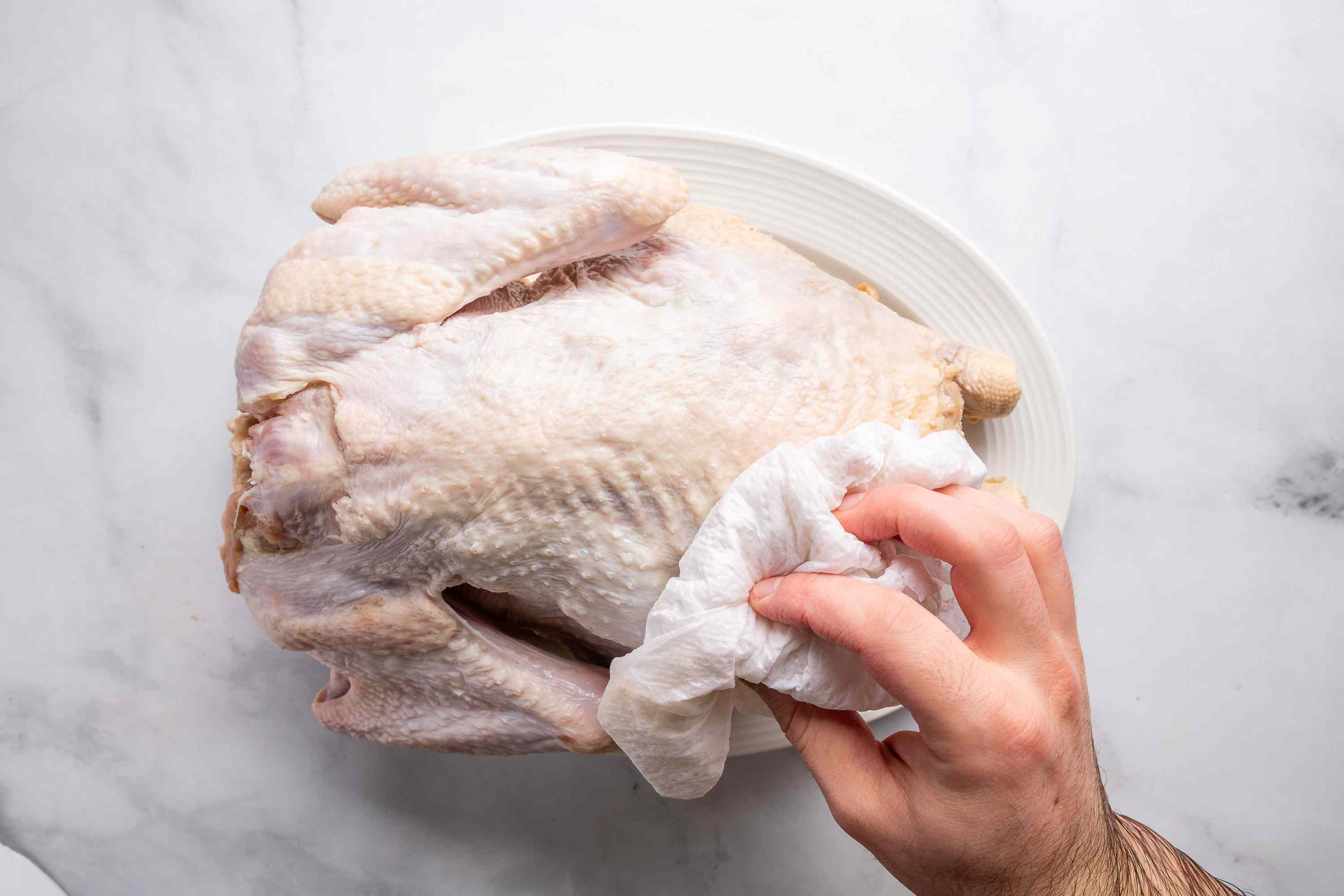 Remove the turkey from brine and pat dry with paper towels