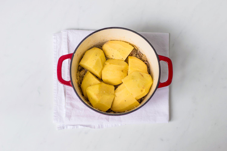 First potato layer in a Scottish stovies recipe