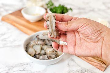 Remove shells and devein shrimp
