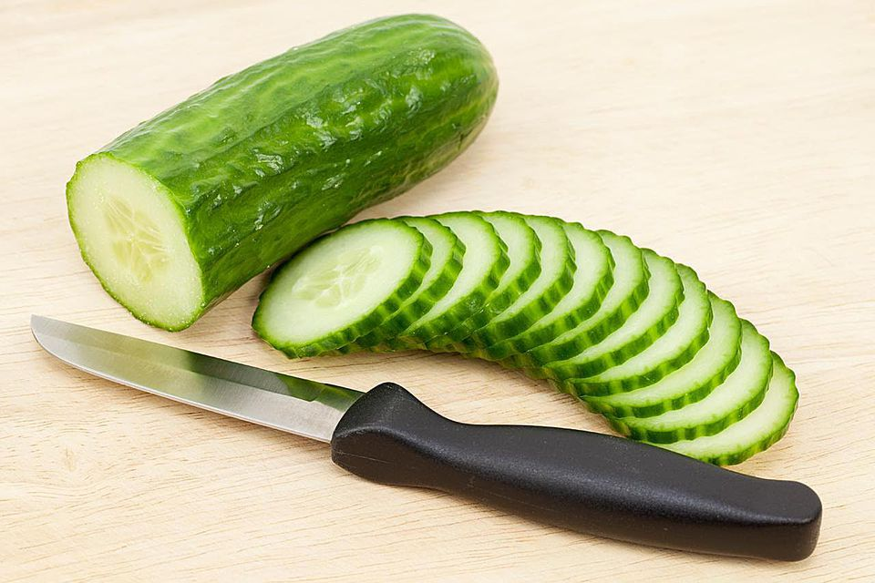 Sliced cucumbers by a knife