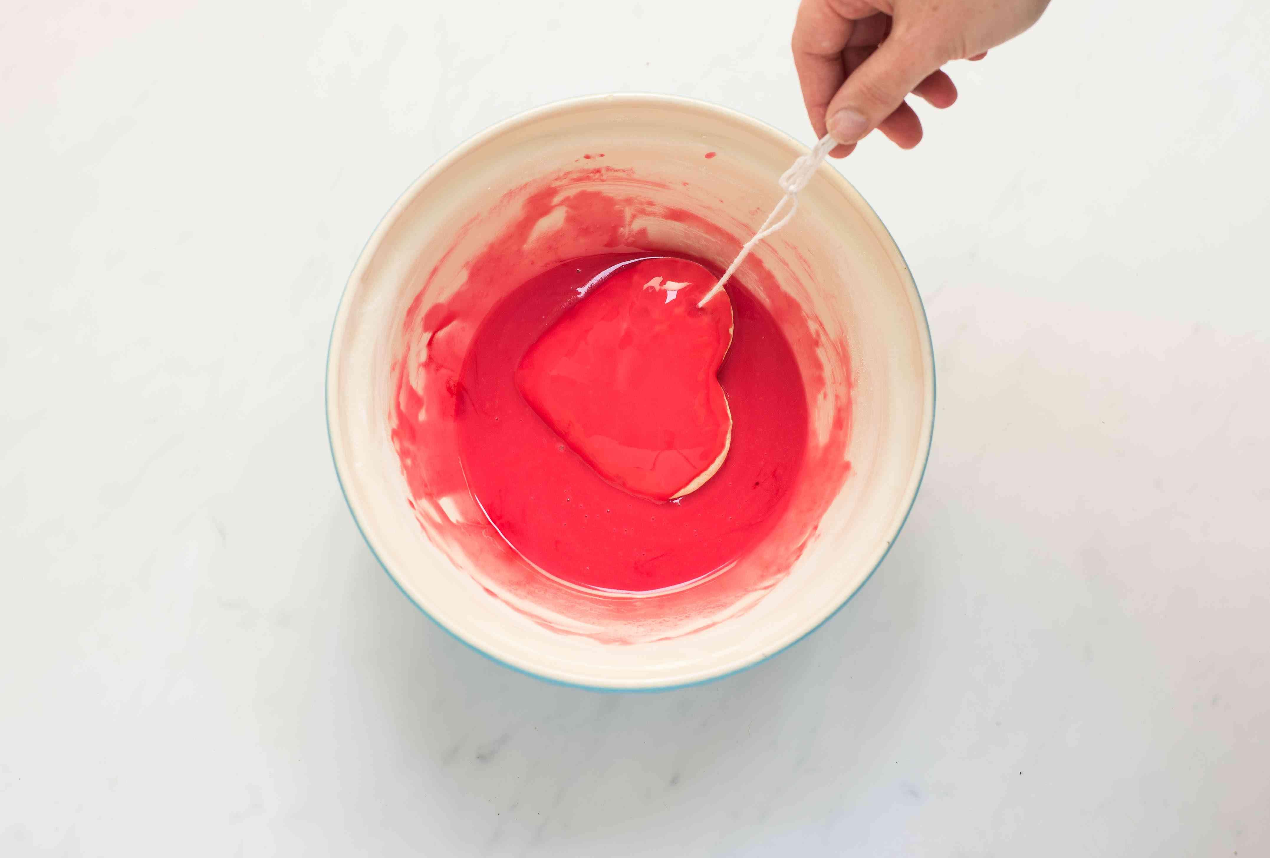Dip cookie in red dye