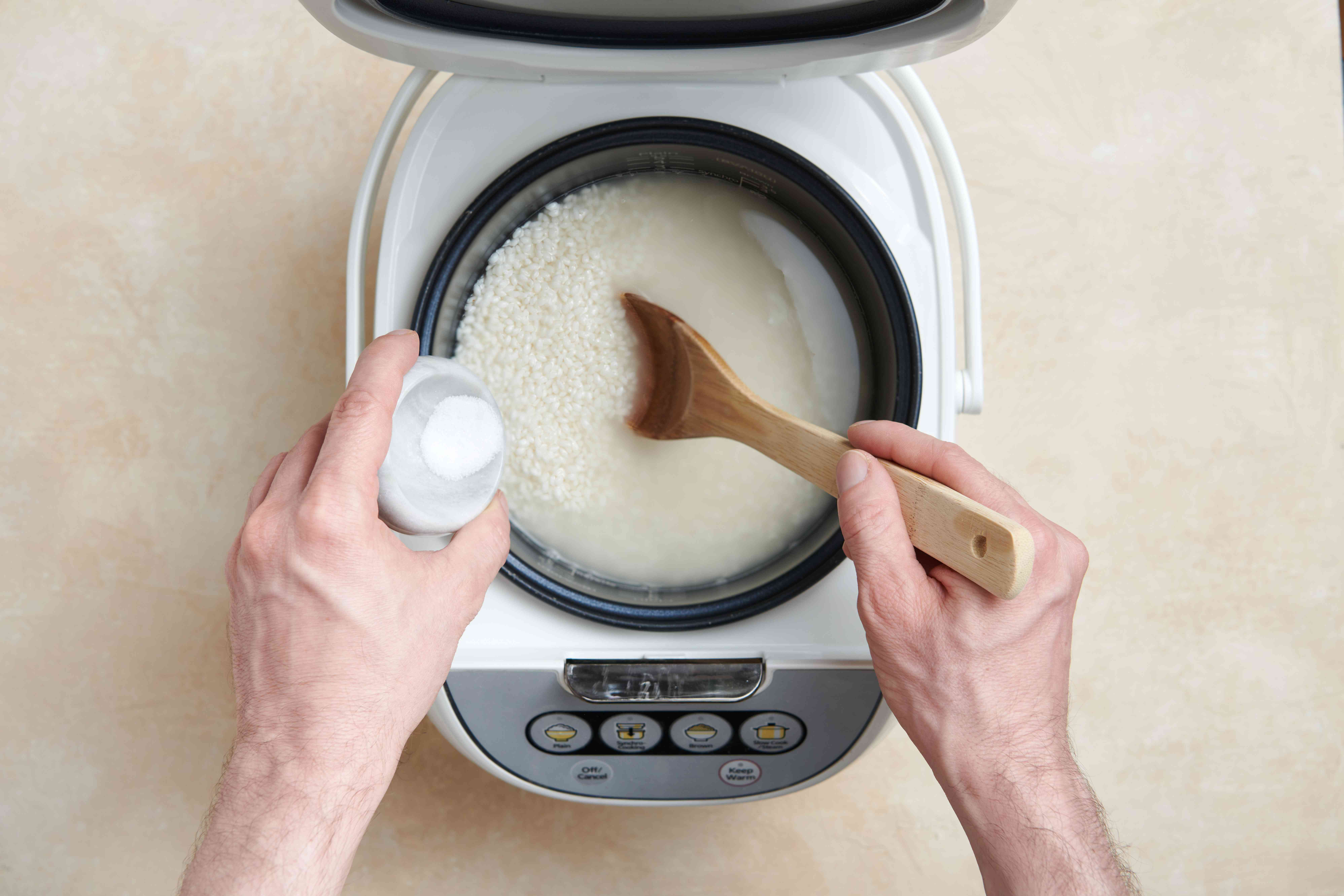 add salt to the rice in the rice cooker