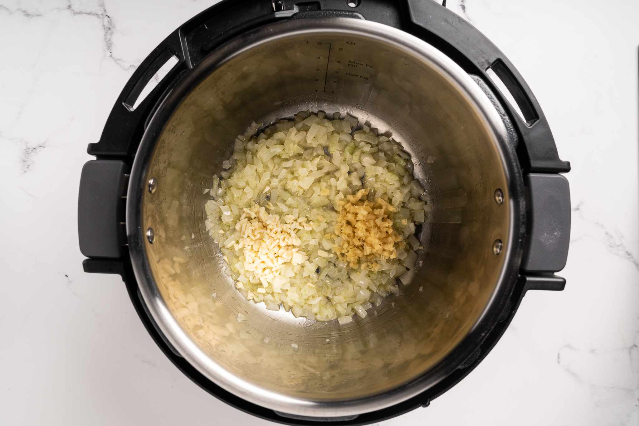 onions, garlic and ginger with butter in an instant pot