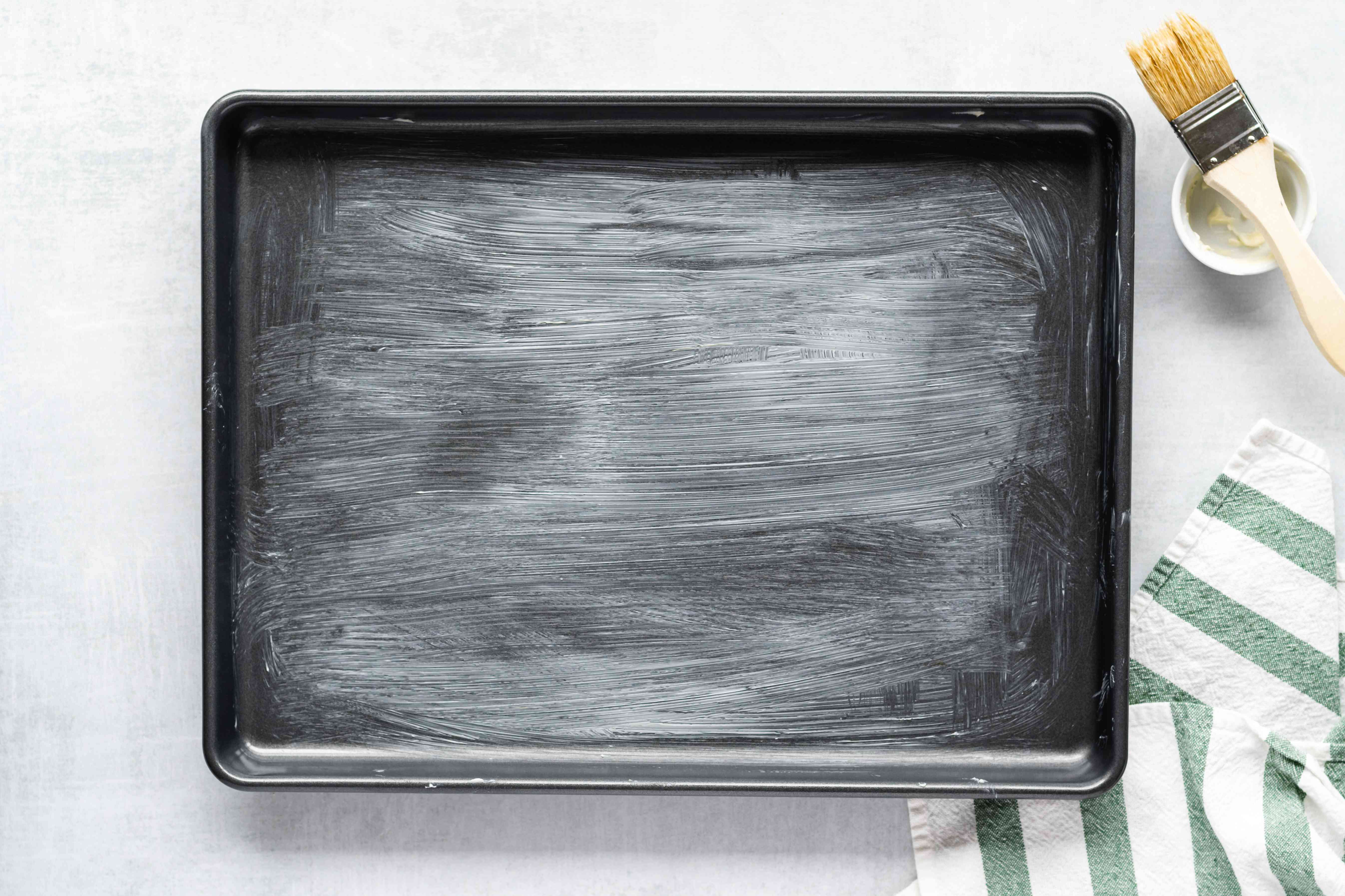 baking sheet brushed with butter