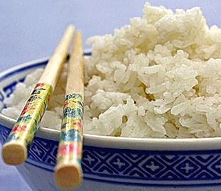 Thai Coconut Rice in bowl with chopsticks