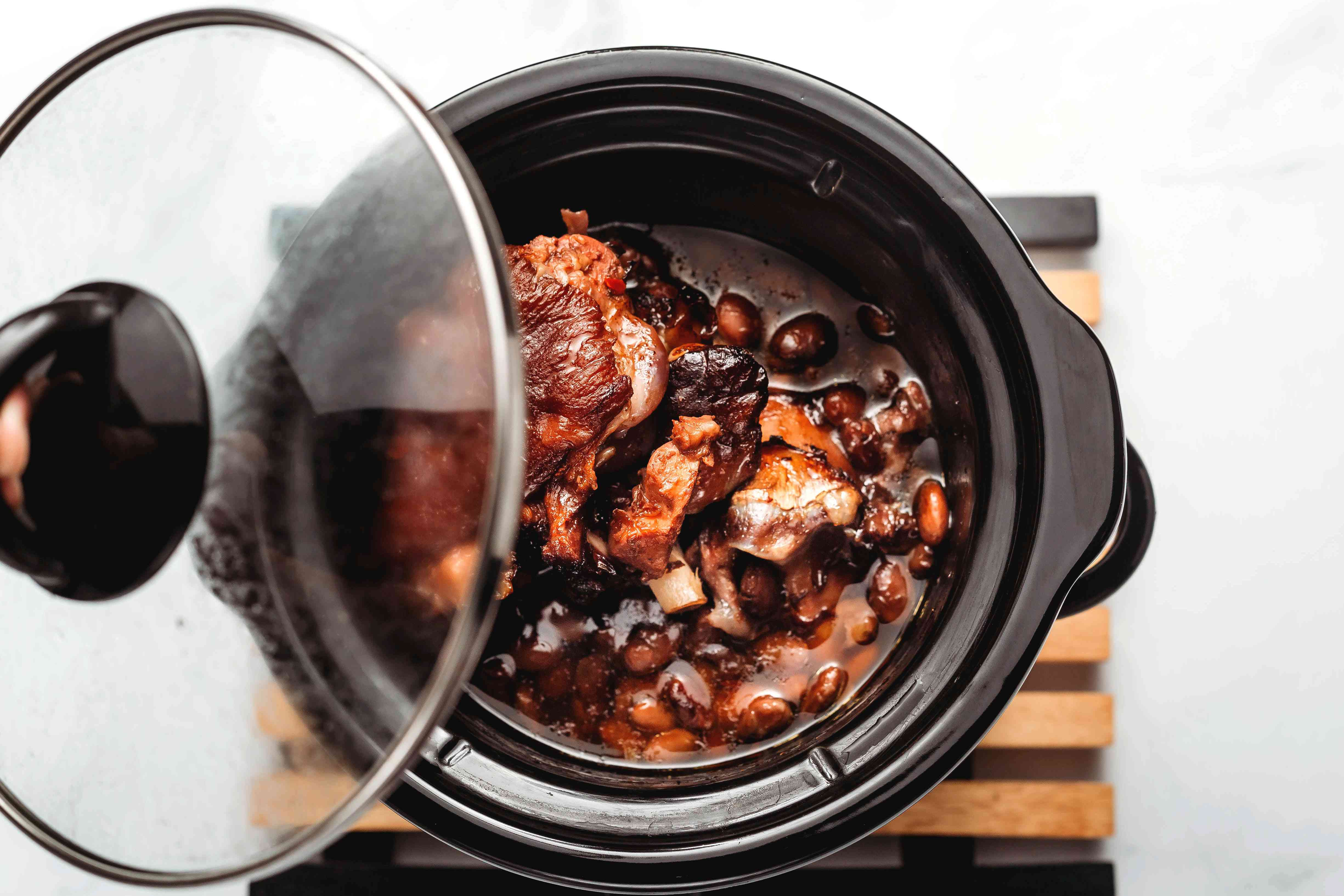 Beans and ham hocks cooking in a crock pot