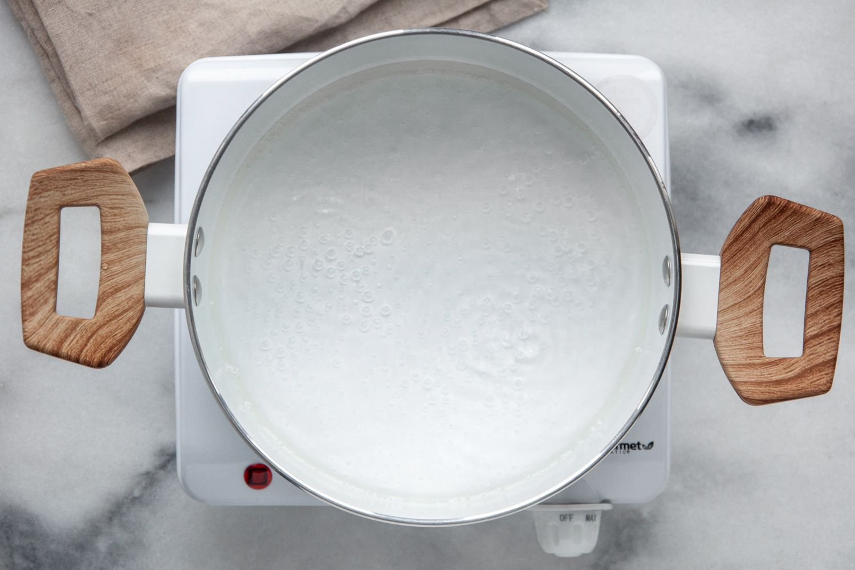 Combine water, vegetable oil, salt, and sugar.