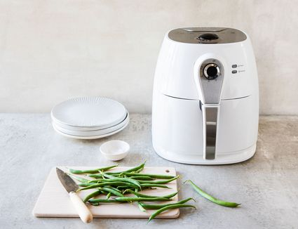 green beans being prepped for cooking in an air fryer