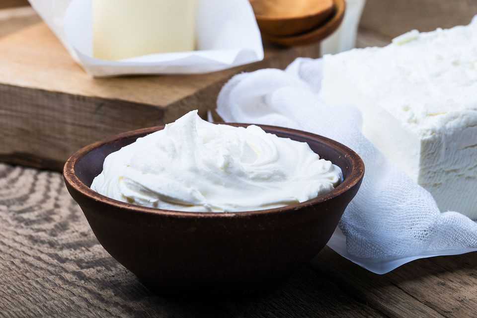 Sour Cream. Organic Dairy Products on Rustic Wooden Table
