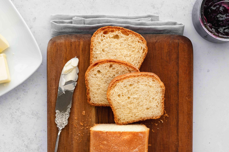 White Bread Mini Loaf sliced on a wood cutting board