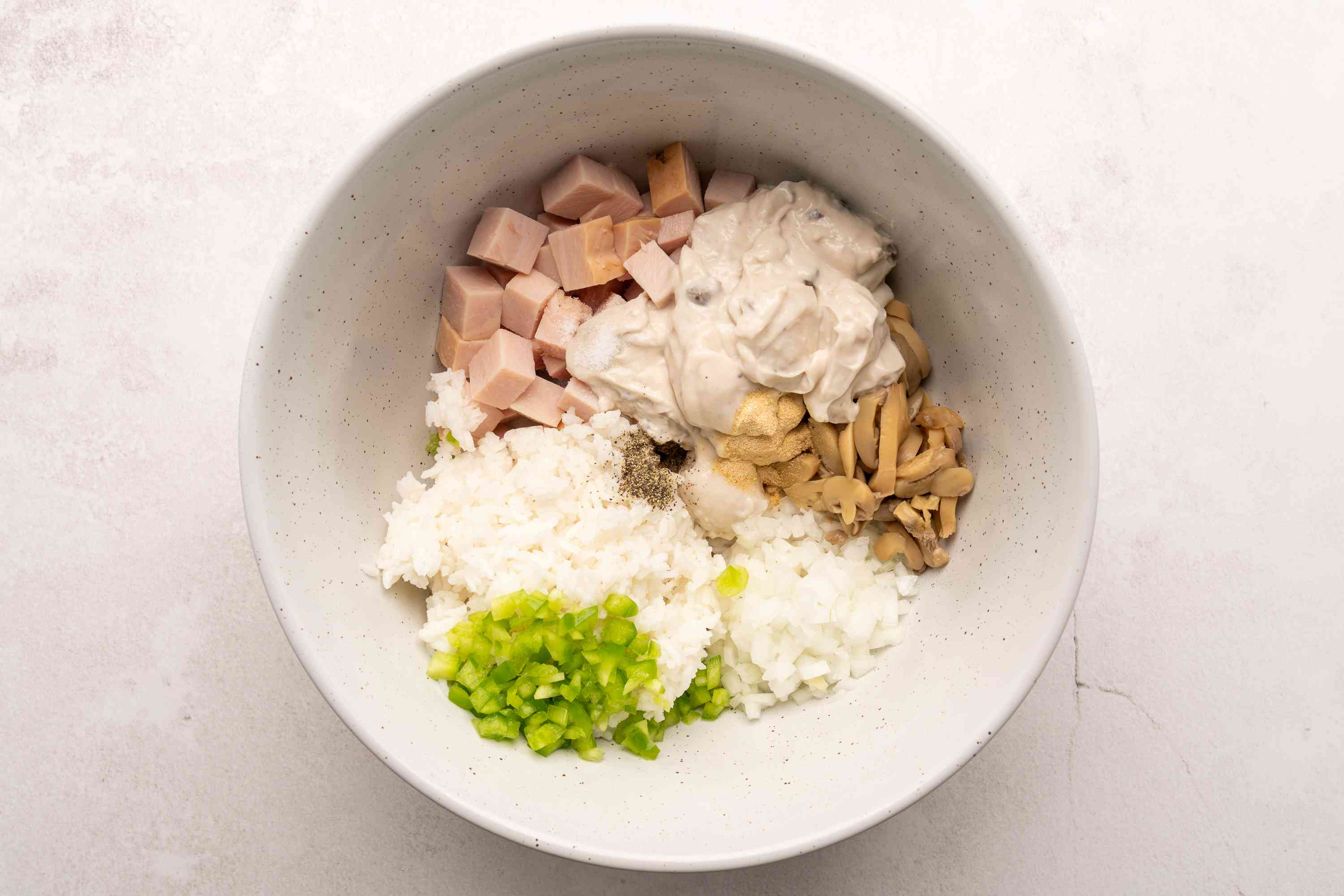 Combine all ingredients for turkey casserole in a large bowl