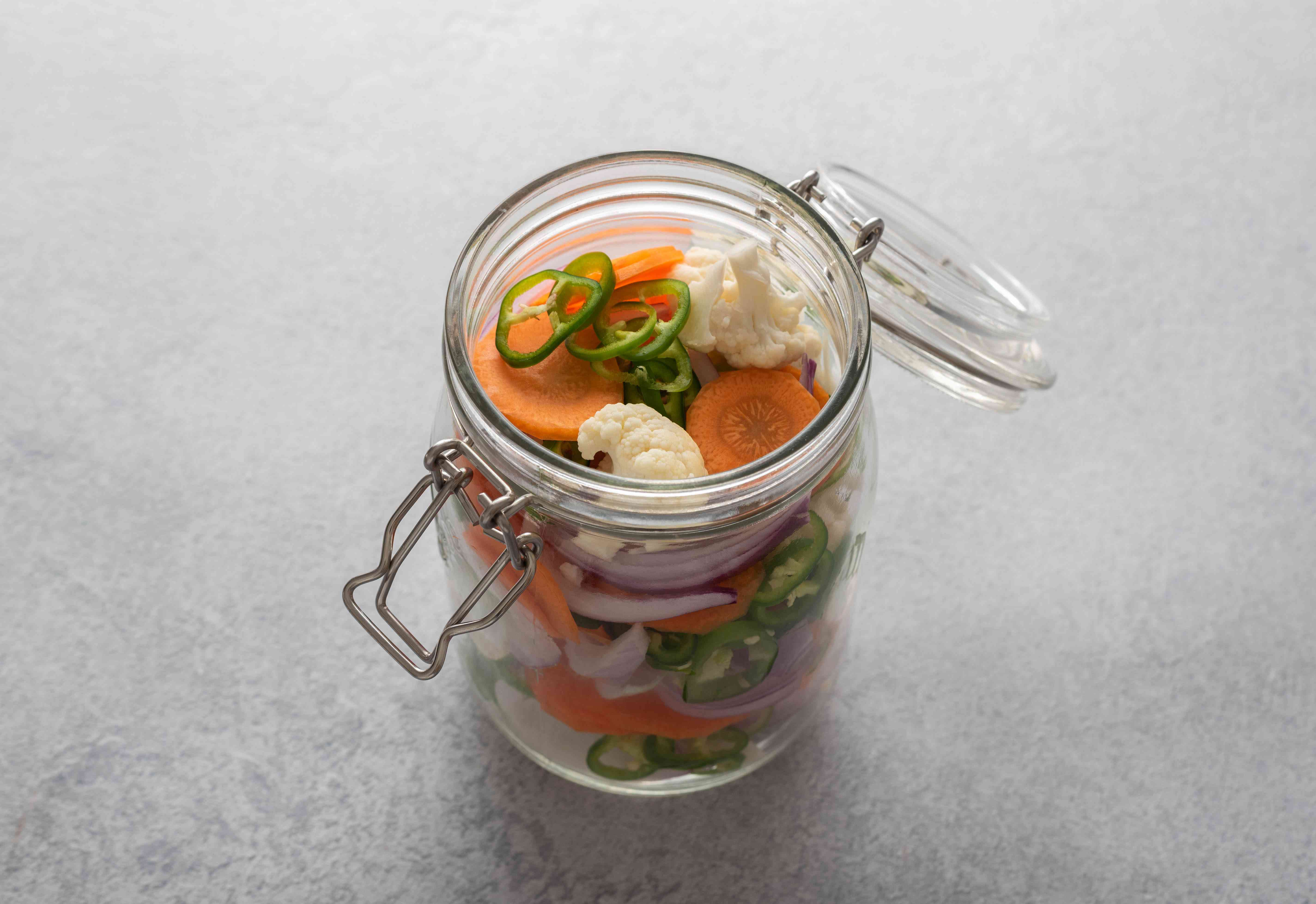 cauliflower, carrots, onion, and chiles in a wide-mouthed quart jar