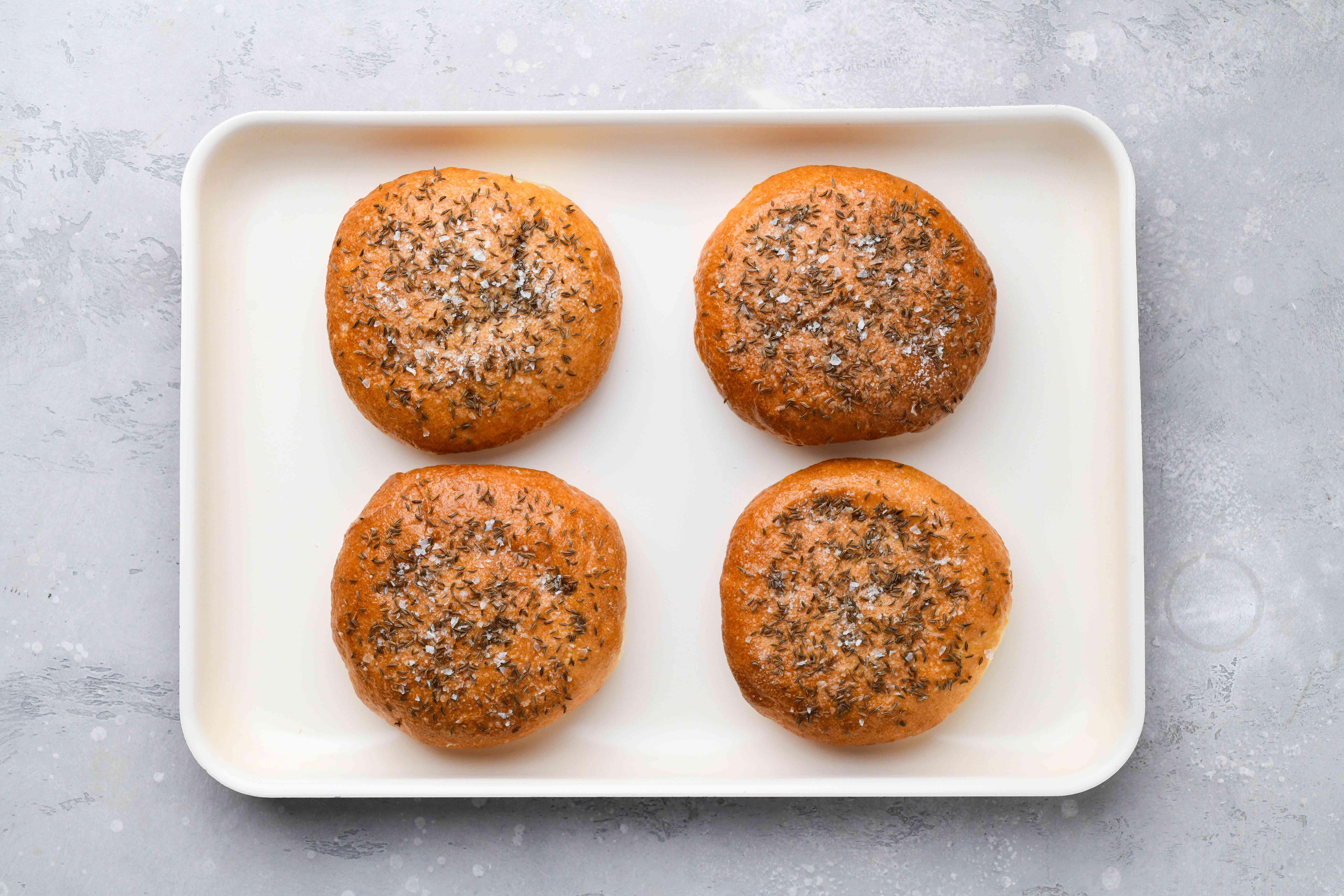 seasoned rolls on a baking sheet
