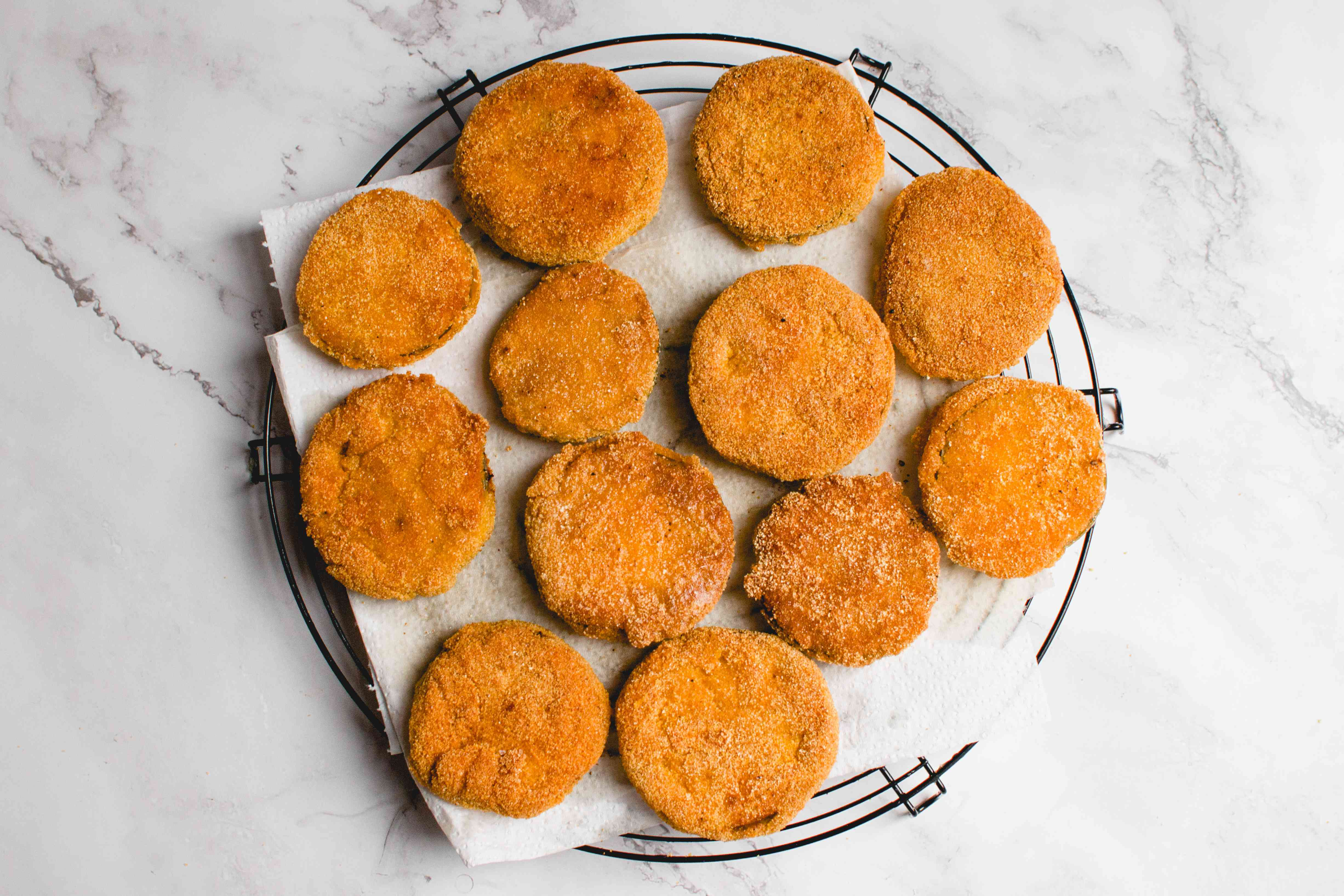 Classic Fried Green Tomatoes on paper towels and a cooling rack