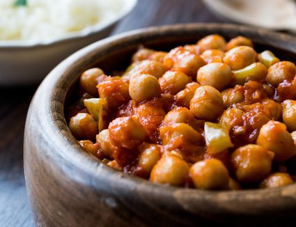 Chana masala chickpeas in wooden bowl