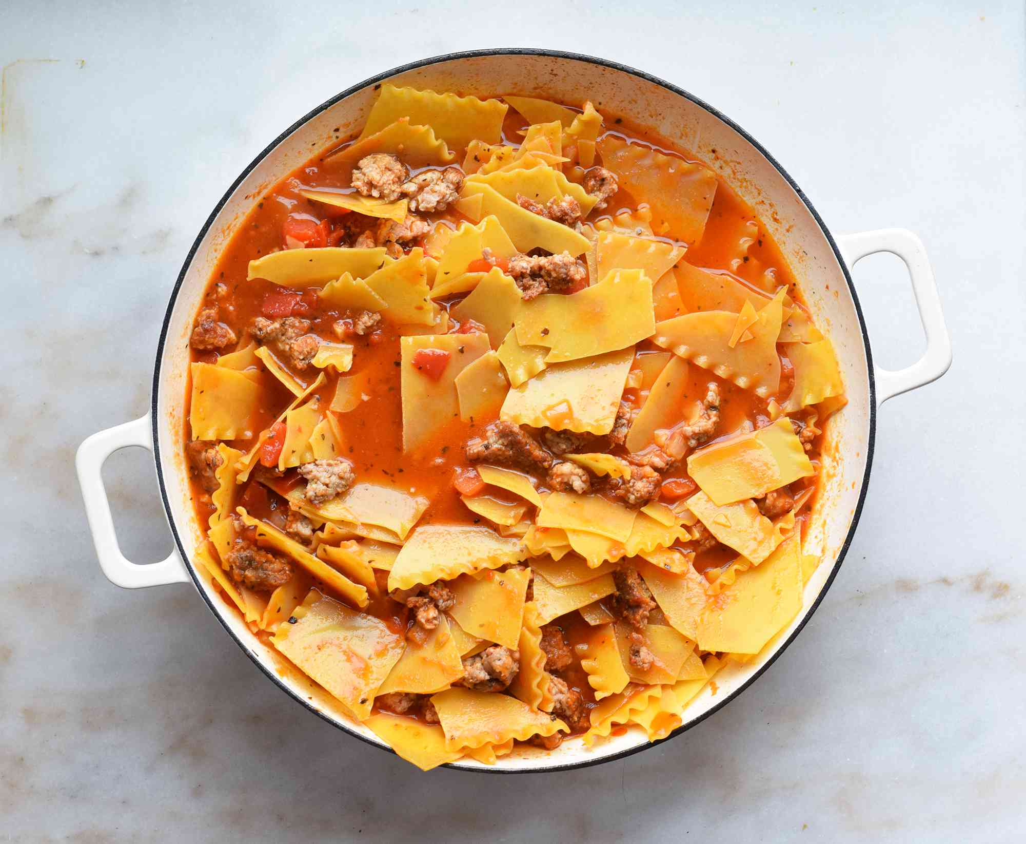 lasagna noodles in a sauce filled pan