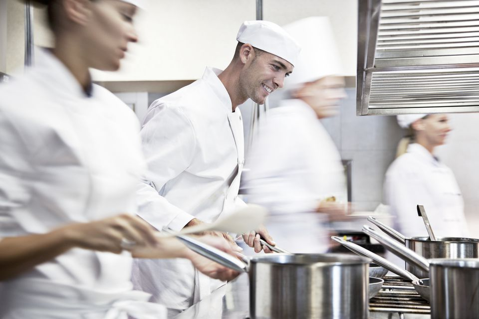 chefs cooking in pots