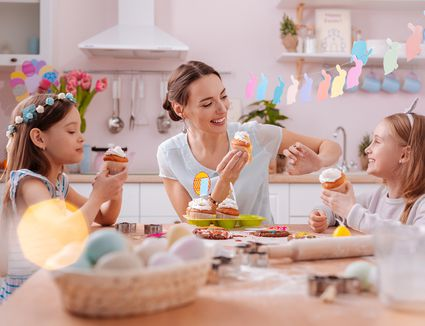 Positive Delighted Female Person Playing With Her Kids