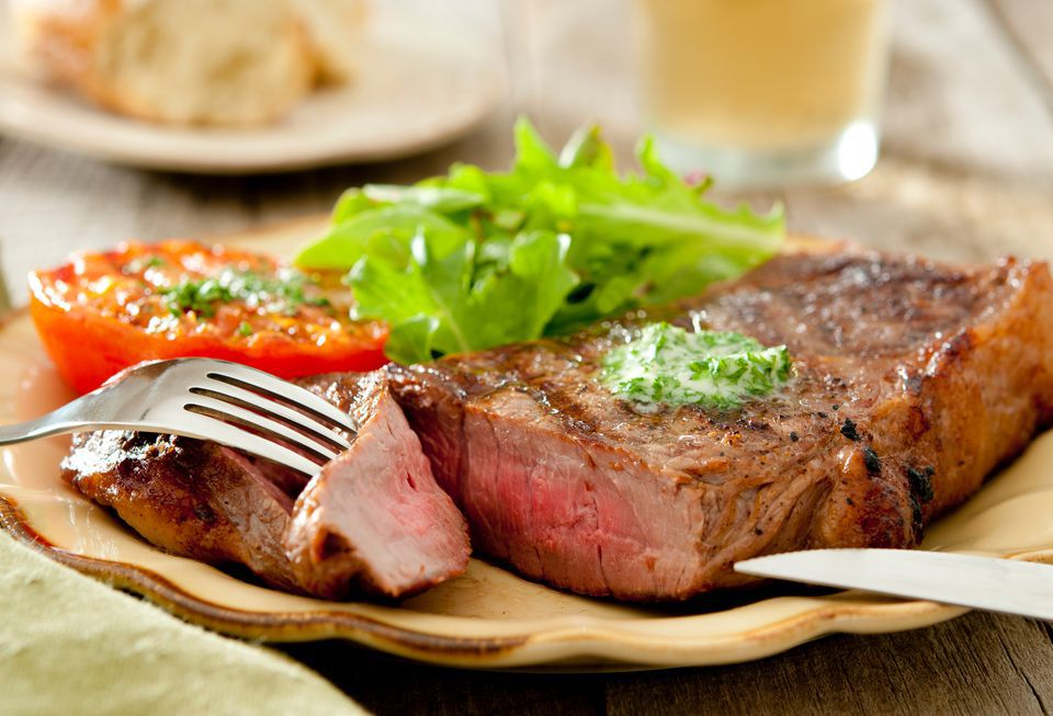 Grilled strip steak with a dollop of compound butter